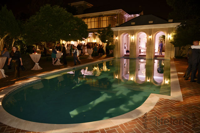 mansion with pool at night